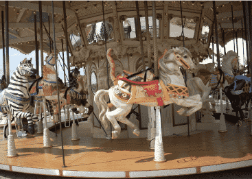 Carousel with white horses