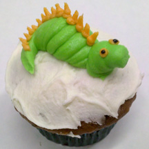 Dragon party cupcake with green dragon in frosting
